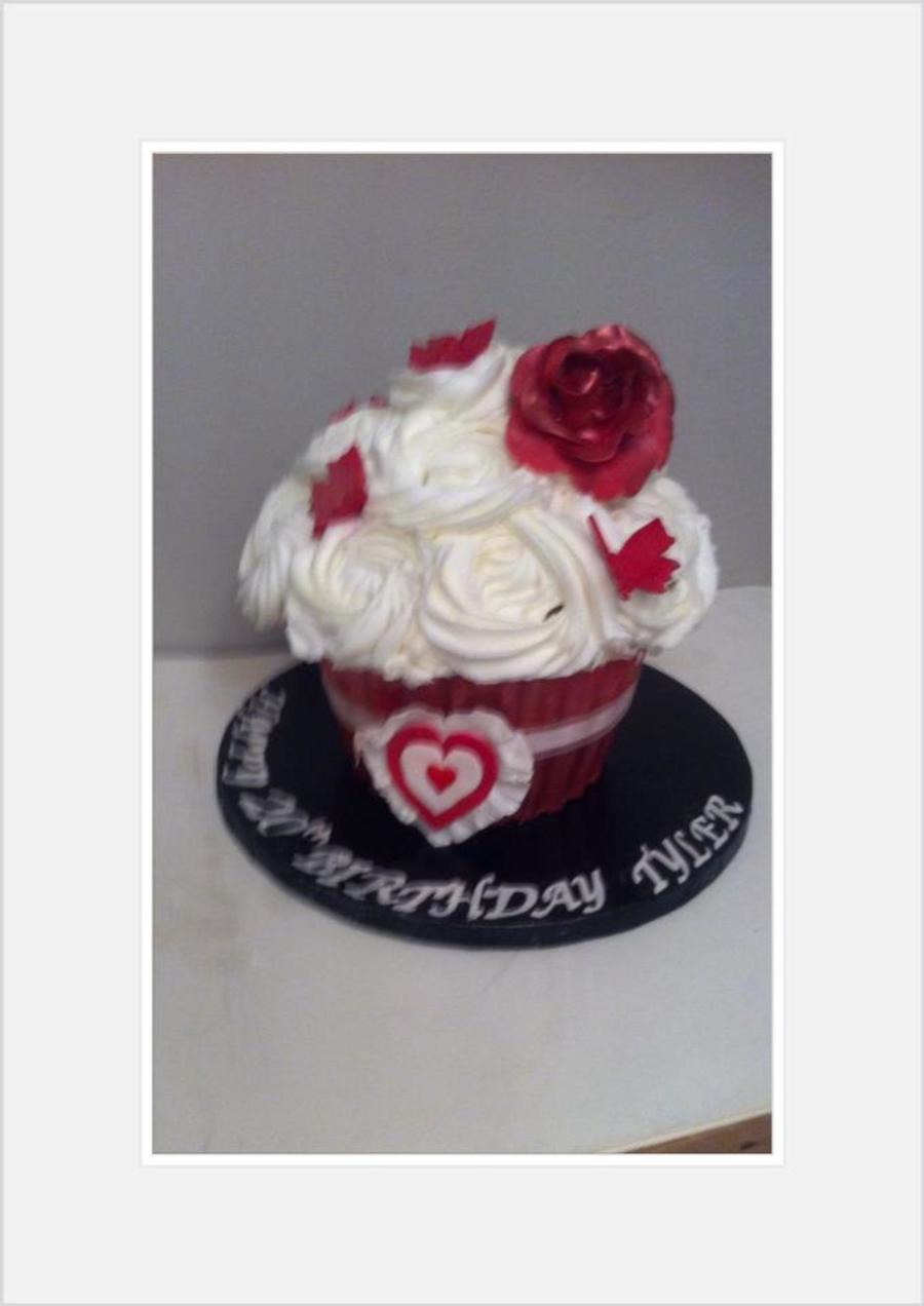 Giant Cupcake With A Chocolate Case Topped With Rose Swirls And An Edible Frilly Heart X on Cake Central