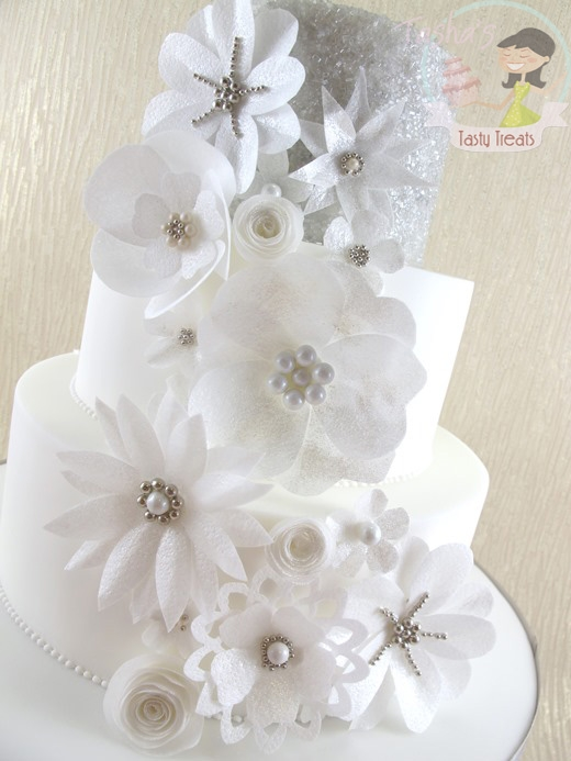 Wafer paper flowers wedding cake cakecentral a new display cake for this season featuring delicate shimmering wafer paper flowers in the style of fabric 3d flowers from bridal gowns mightylinksfo