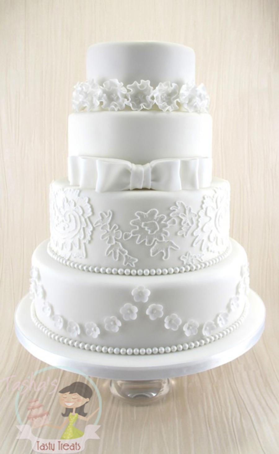 White Classic 4 Tier Wedding Cake - CakeCentral.com