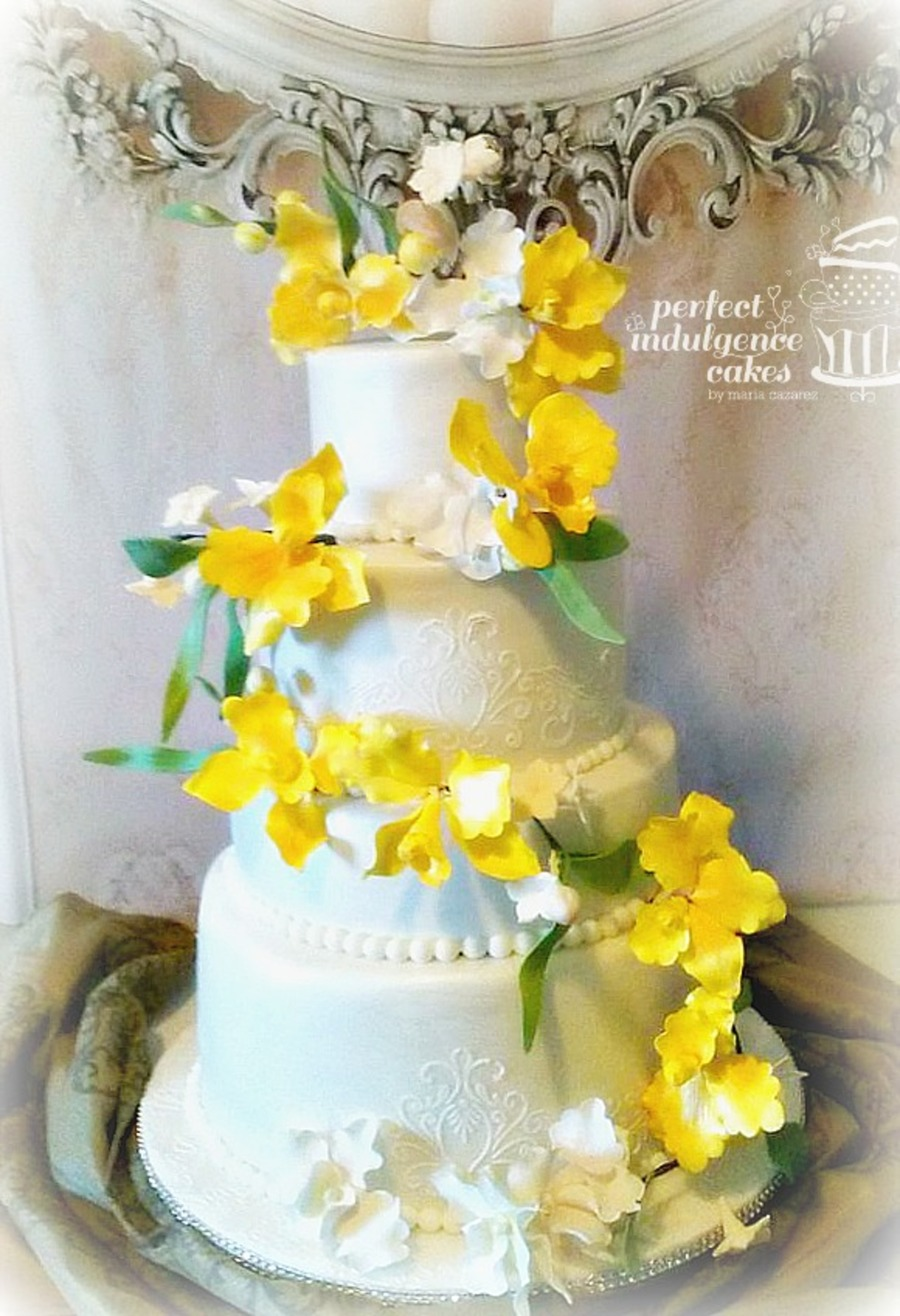 4 Tier Wedding Cake Decorated With Yellow Orchids - CakeCentral.com