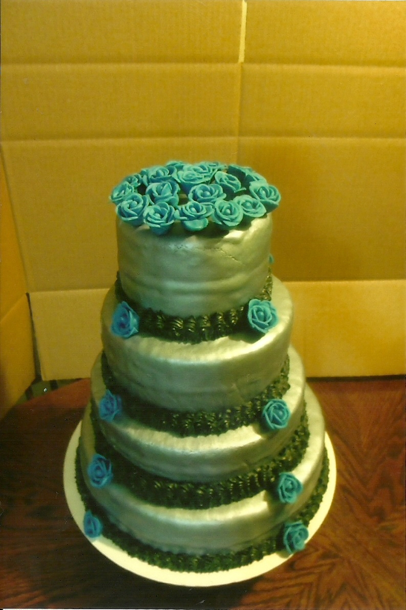 Wedding Cake With Silver Fondant And Blue Mmf Flowers - CakeCentral.com