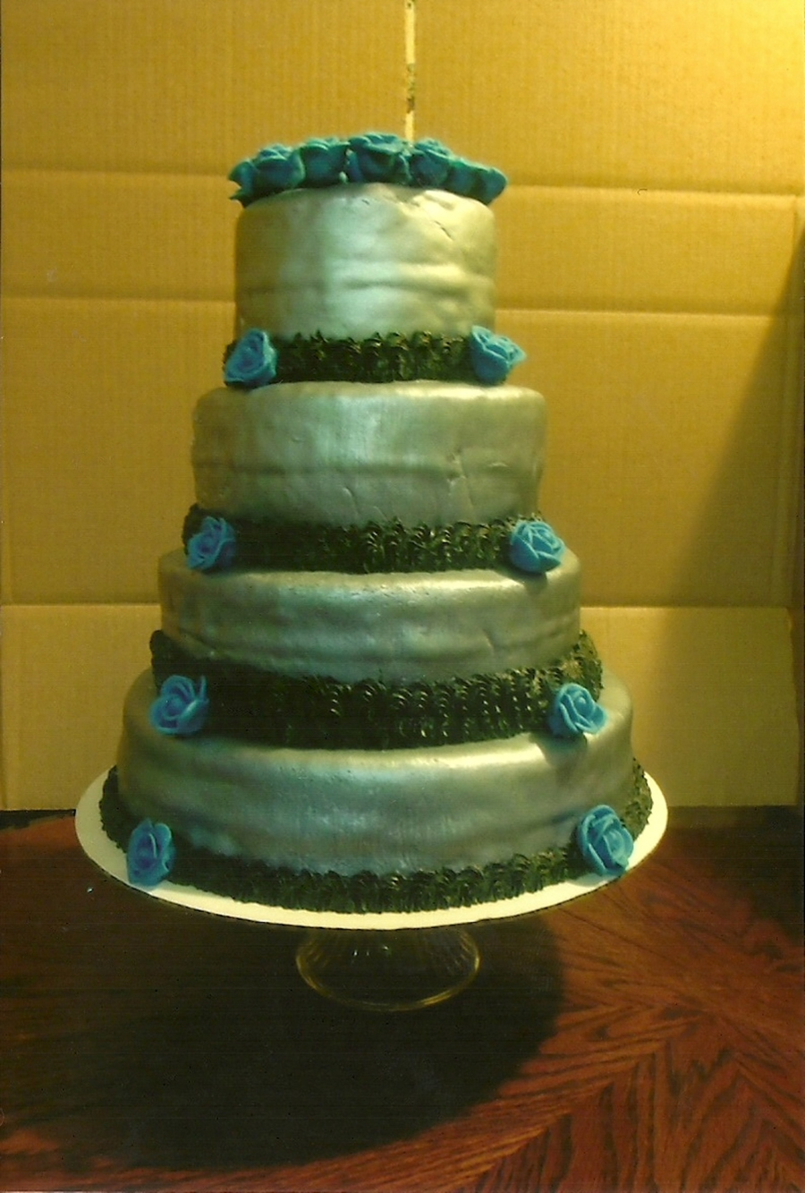 silver fondant wedding cake wedding cake with silver fondant and blue flowers 19860