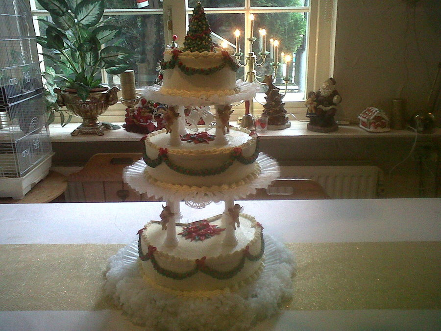 Traditional Cake With Angel Pillars And Bells Cone Covered In Buttercream Christmas Tree On Top I Added Little Lights In The Fake Snow On on Cake Central