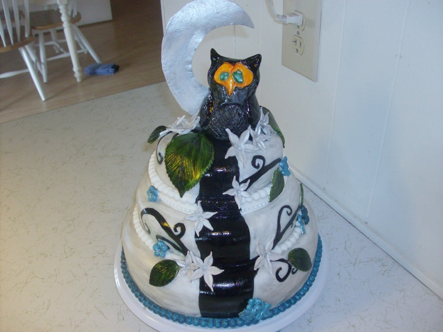 A Three Tier Owel Themed Birthday Cake. Its Colors Are Silver,blue, And Black. It Has Fondant And Gum Paste Accents. on Cake Central