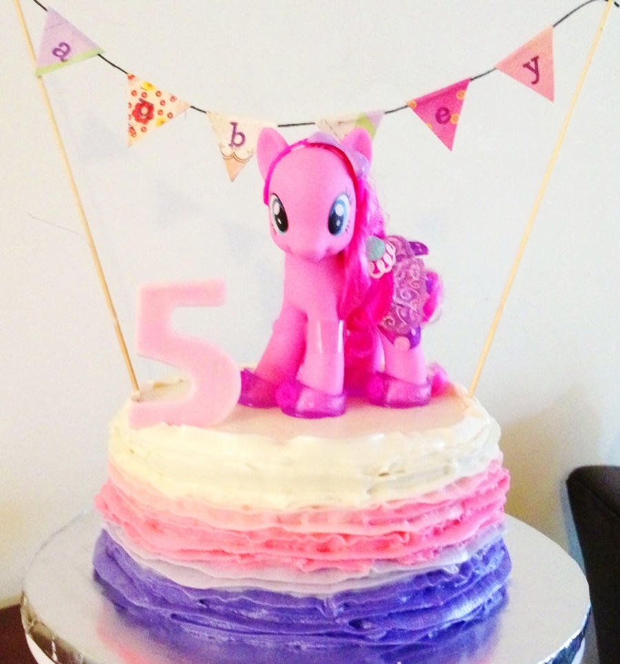 900 878089UtJ7 my little pony cake with buttercream ruffles and hand made banner - My Little Pony Party Ideas