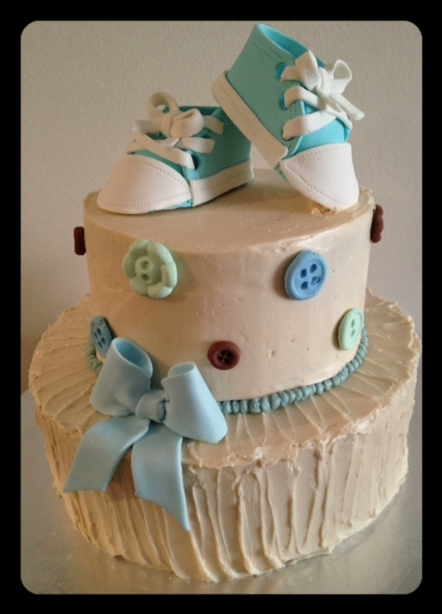 italian buttercream baby shower cake with gumpaste baby shoes
