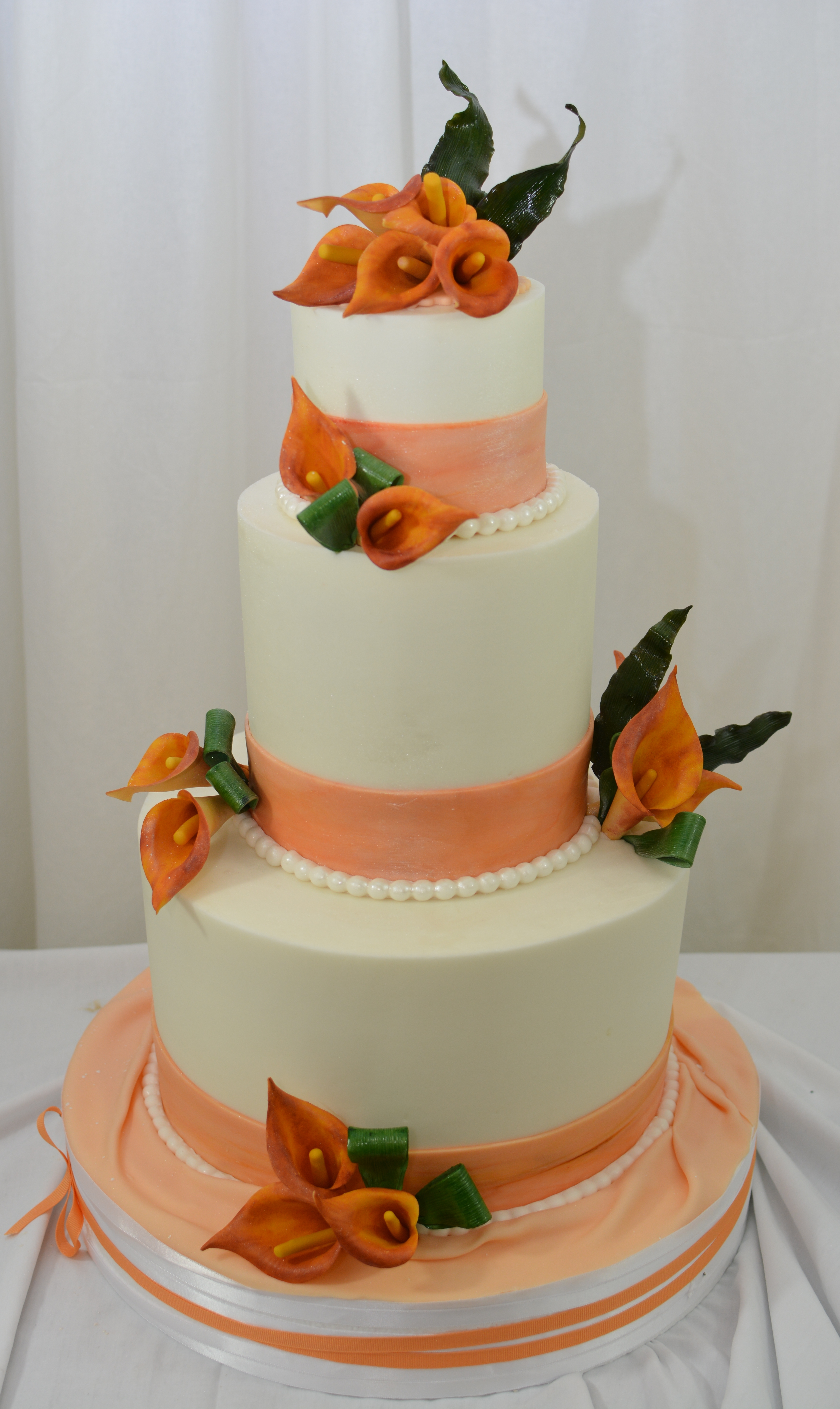 4610 Finished In Buttercream With Fondant Accents And Gumpaste Mango Calla Lilies on Cake Central