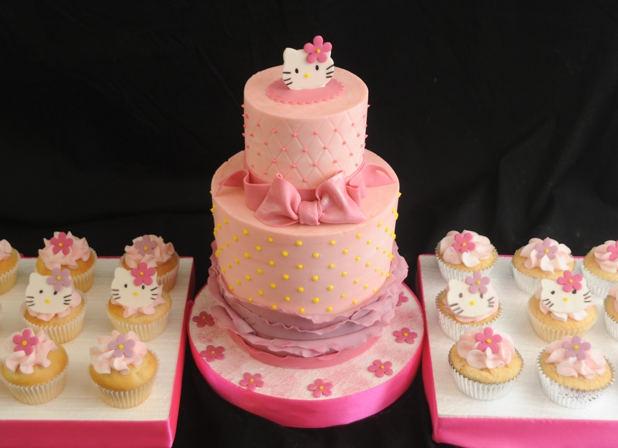 Hello Kitty Cake Finished In Buttercream With Fondant Accents 4Inch And 6 Inch With Cupcakes on Cake Central