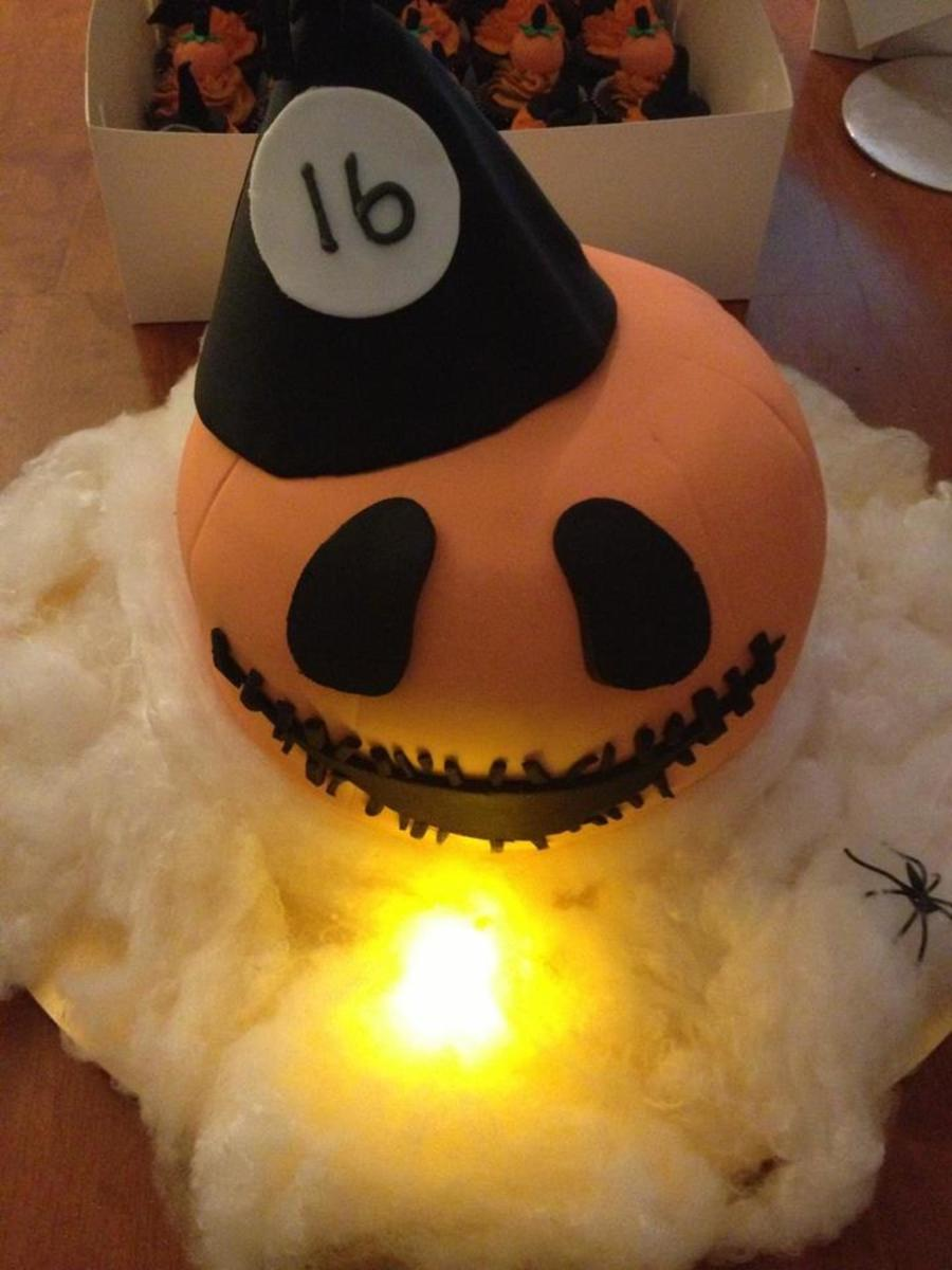 16Th Birthday Pumpkin Cake With Party Hat And A Little Light To Up His Face