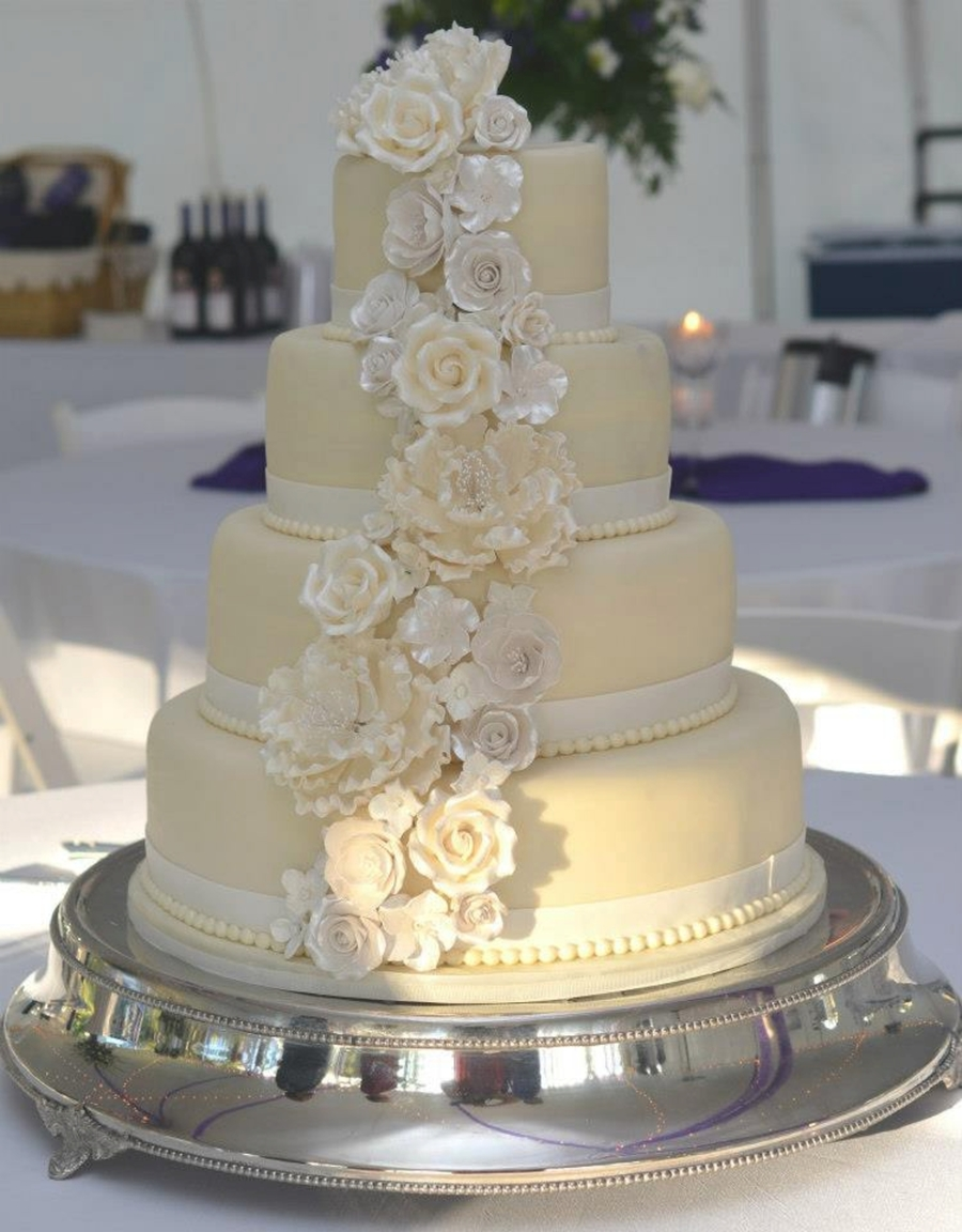 4 Tier Round Wedding Cake Covered In White Chocolate Fondant And Adorned With A Cascade Of Gumpaste Flowers on Cake Central