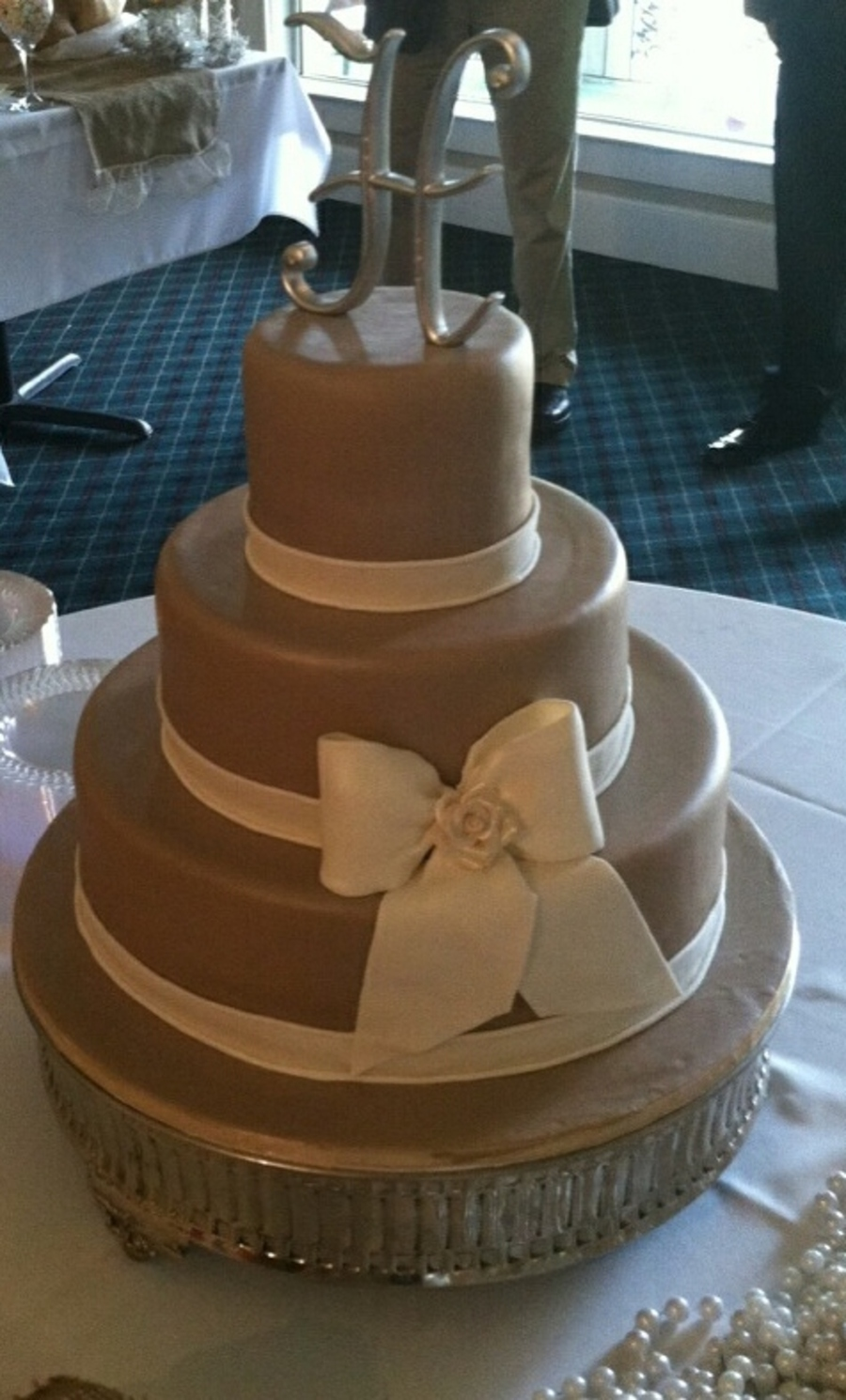 3 Tier Khaki With Ecru Band And Bow Center Of Bow Is Ecru Gumpaste Rose By Tracy Jordan Simply Southern Specialties  on Cake Central