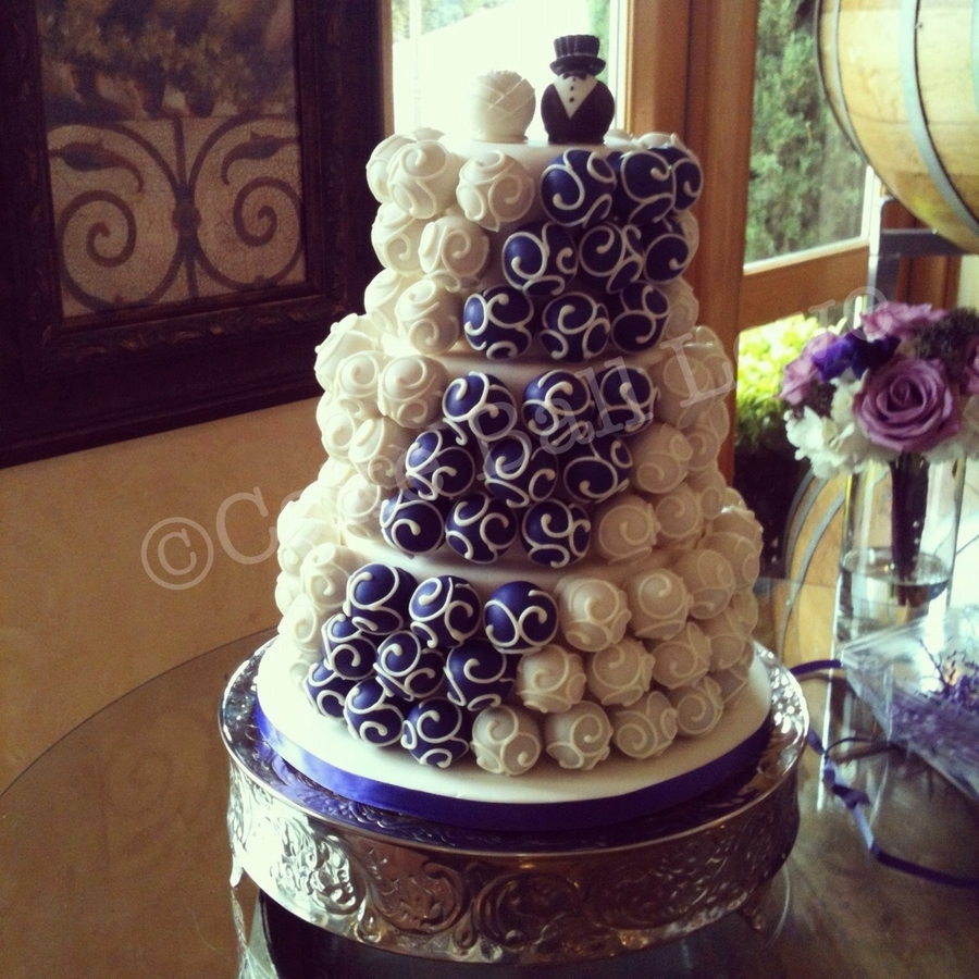 Purple And Ivory Wedding Cake - CakeCentral.com