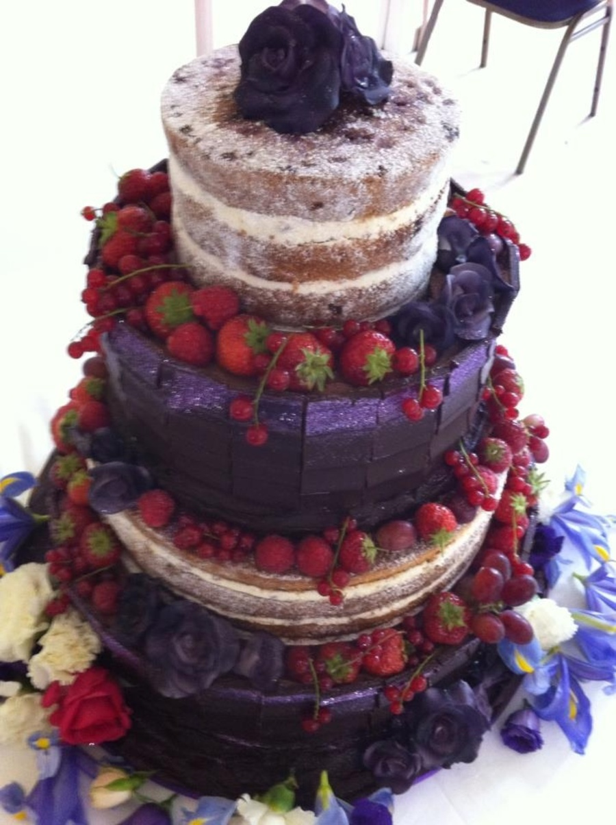 Wedding Cake Decorated With Chocolate Slabs Fruit And Sugar Flowers on Cake Central