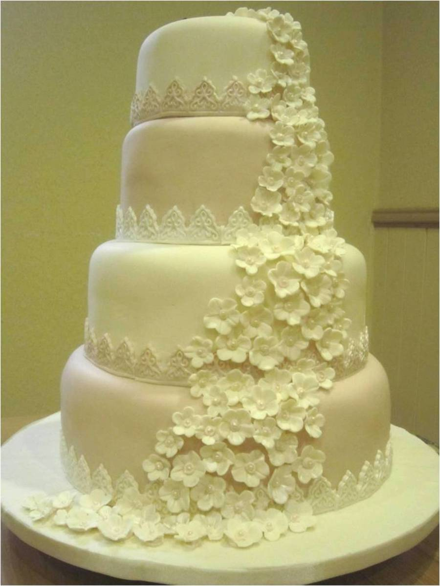 4 tier wedding cake recipe emers wedding cake blossoms cascade with lace borders i 10403