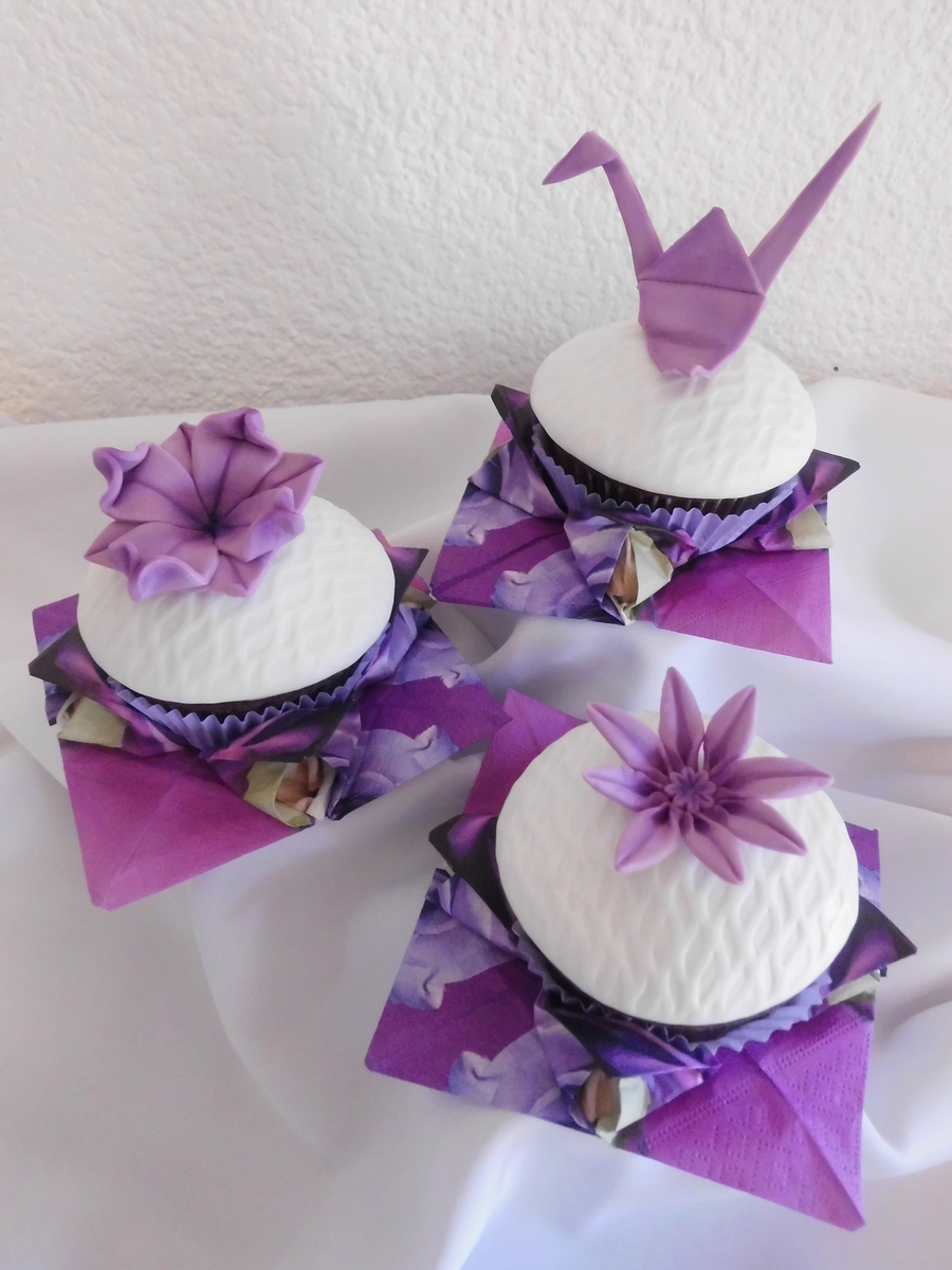 Origami cupcakes cakecentral large cupcakes nestled in paper napkins that are folded into the lotus flower fondant decorations include the crane lotus flower and the eight petal mightylinksfo