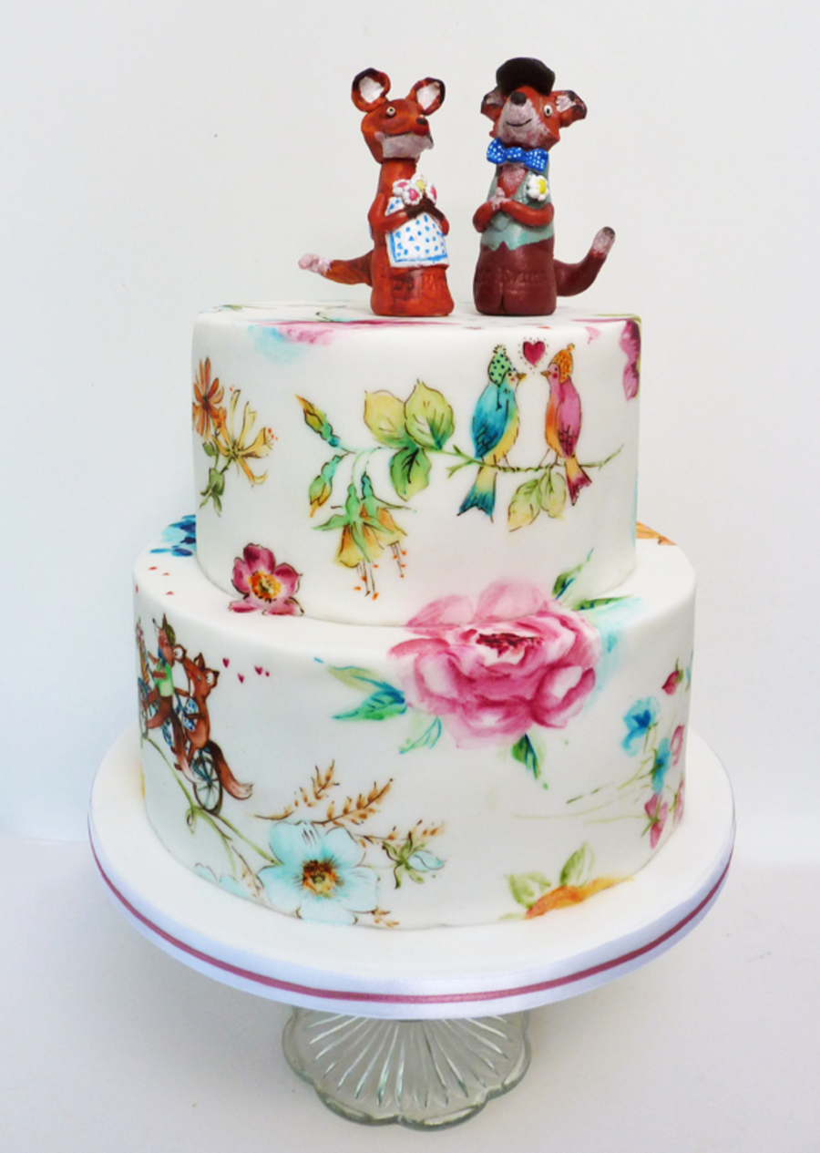 A Quirky Wedding Cake For A Lovely Couple They Made The Toppers Themselves And The Cake Included Paintings Of Birds With Hats And Bicycling... on Cake Central