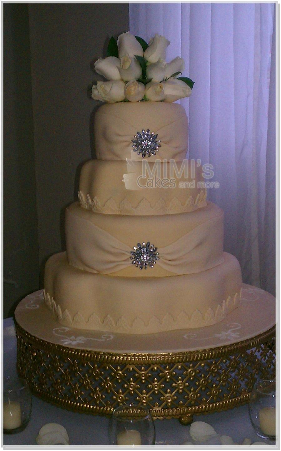 Cream Wedding Cake With Flower And Round Shape on Cake Central