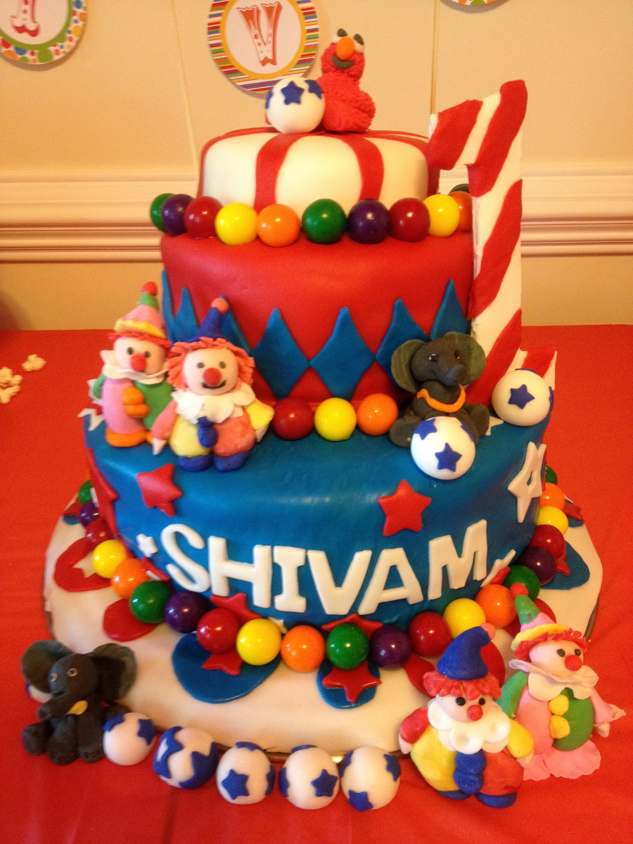 Elmo Smash Cake Atop A Circus Themed First Birthday Cake