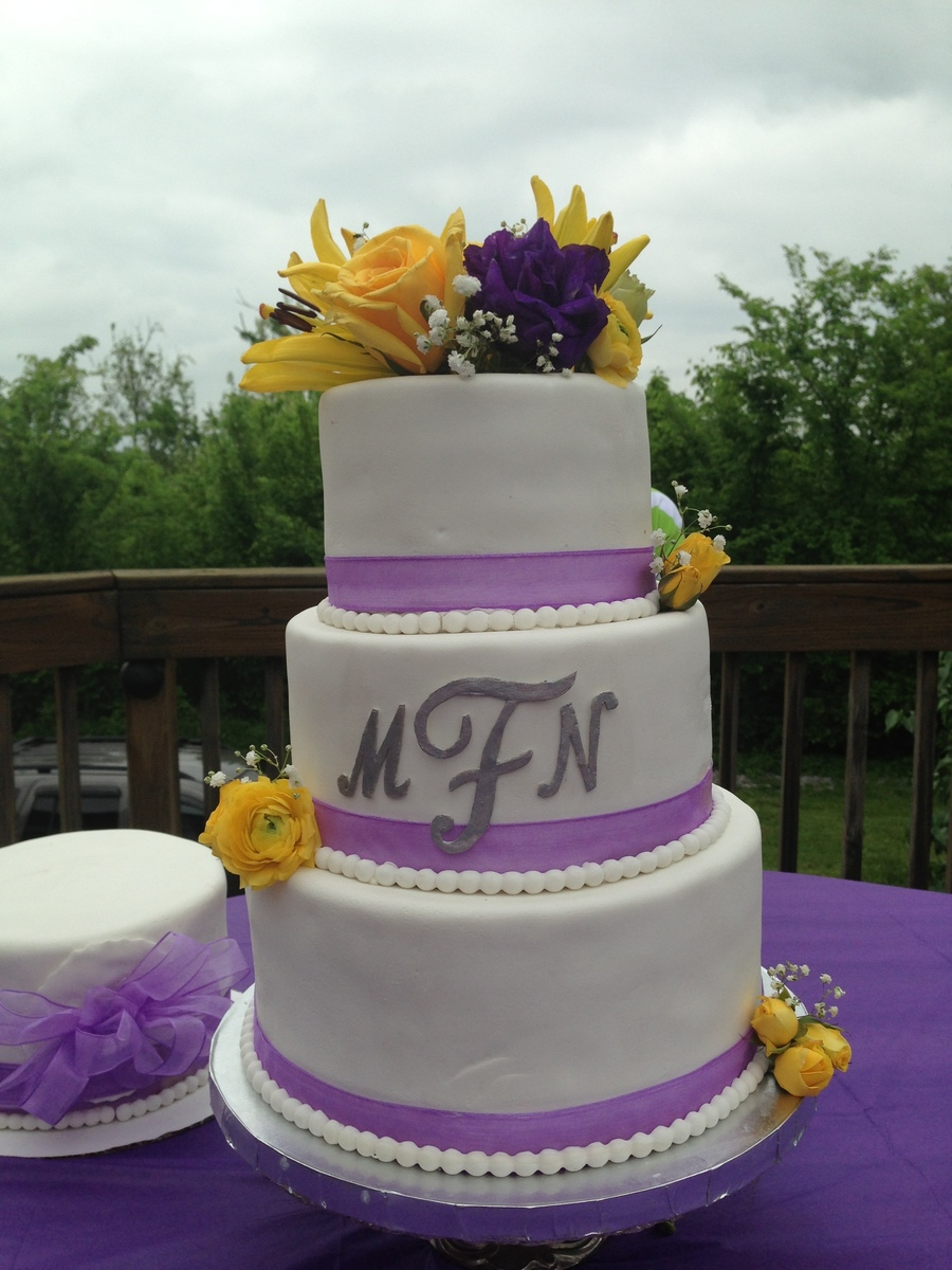 3 tier monogram wedding cake with purple ribbon fondant pearls and fresh flowers. Black Bedroom Furniture Sets. Home Design Ideas