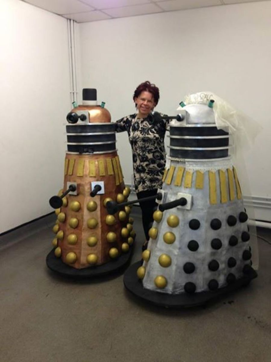 this is me with my almost life size dalek cakes made for a mass