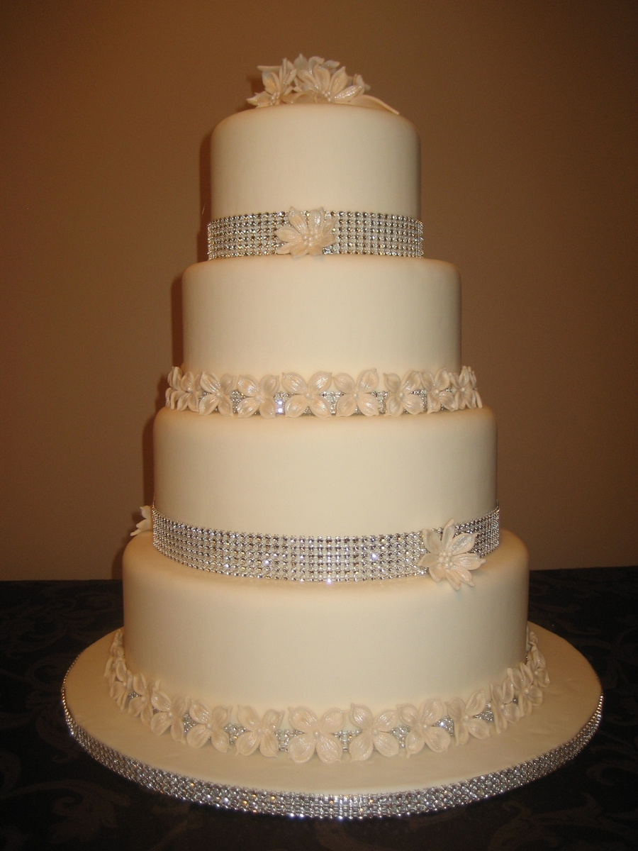 4 Tier Wedding Cake With Flowers And Diamond Wrap - CakeCentral.com