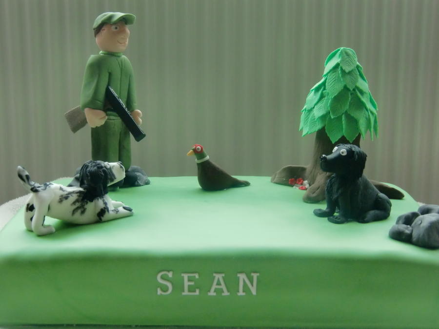 Surprising Shooting Cake The Birthday Man With His Two Dogs Cakecentral Com Personalised Birthday Cards Veneteletsinfo