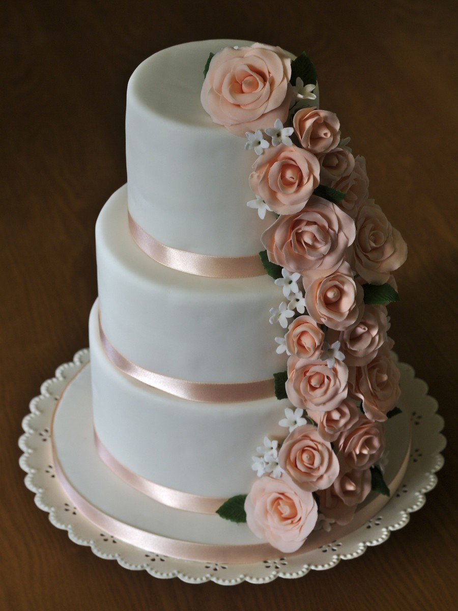 wedding cake with flowers down one side cascade cakecentral 26880
