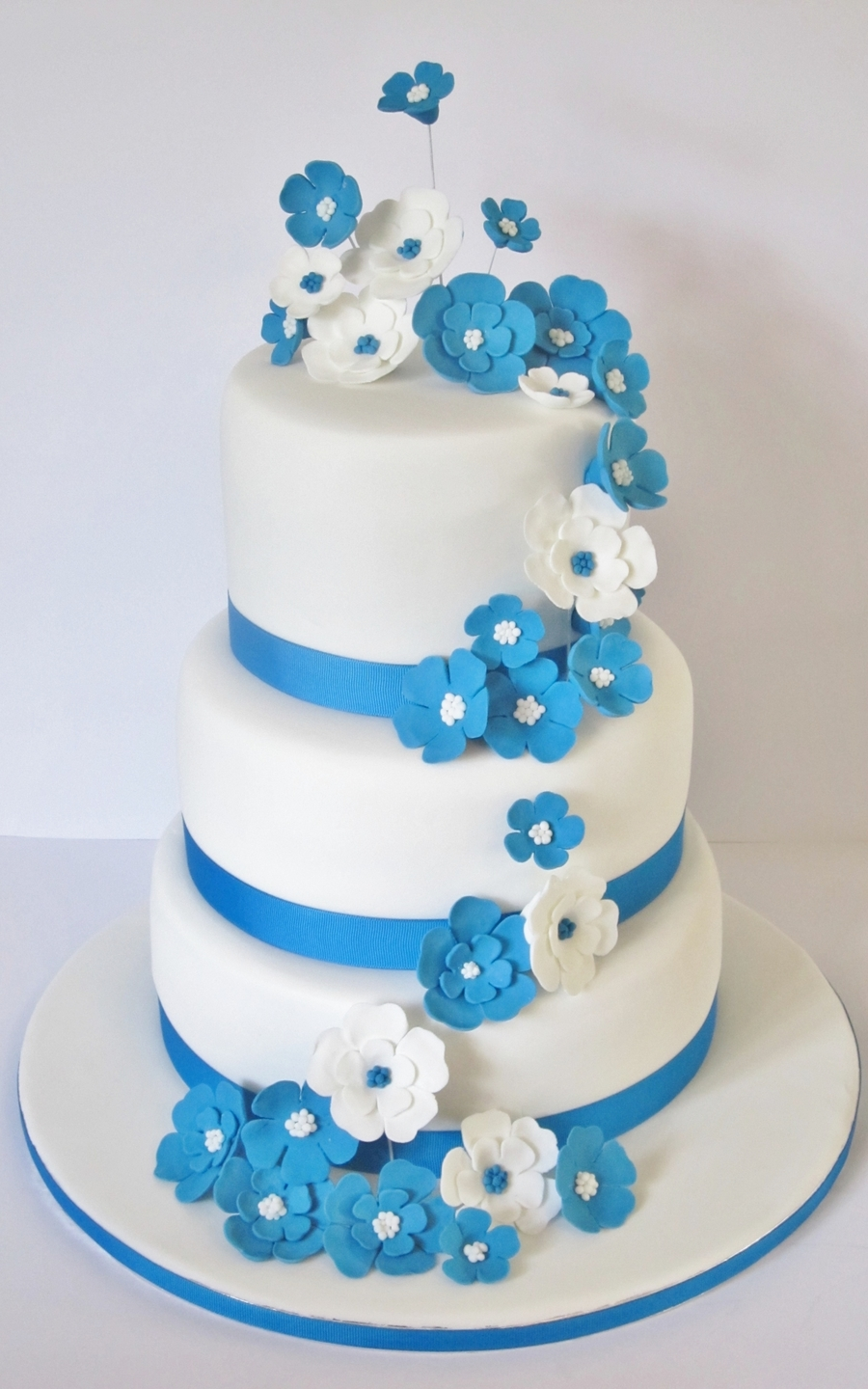 Blue And White Wedding Cake Wth Fondant Flowers - CakeCentral.com