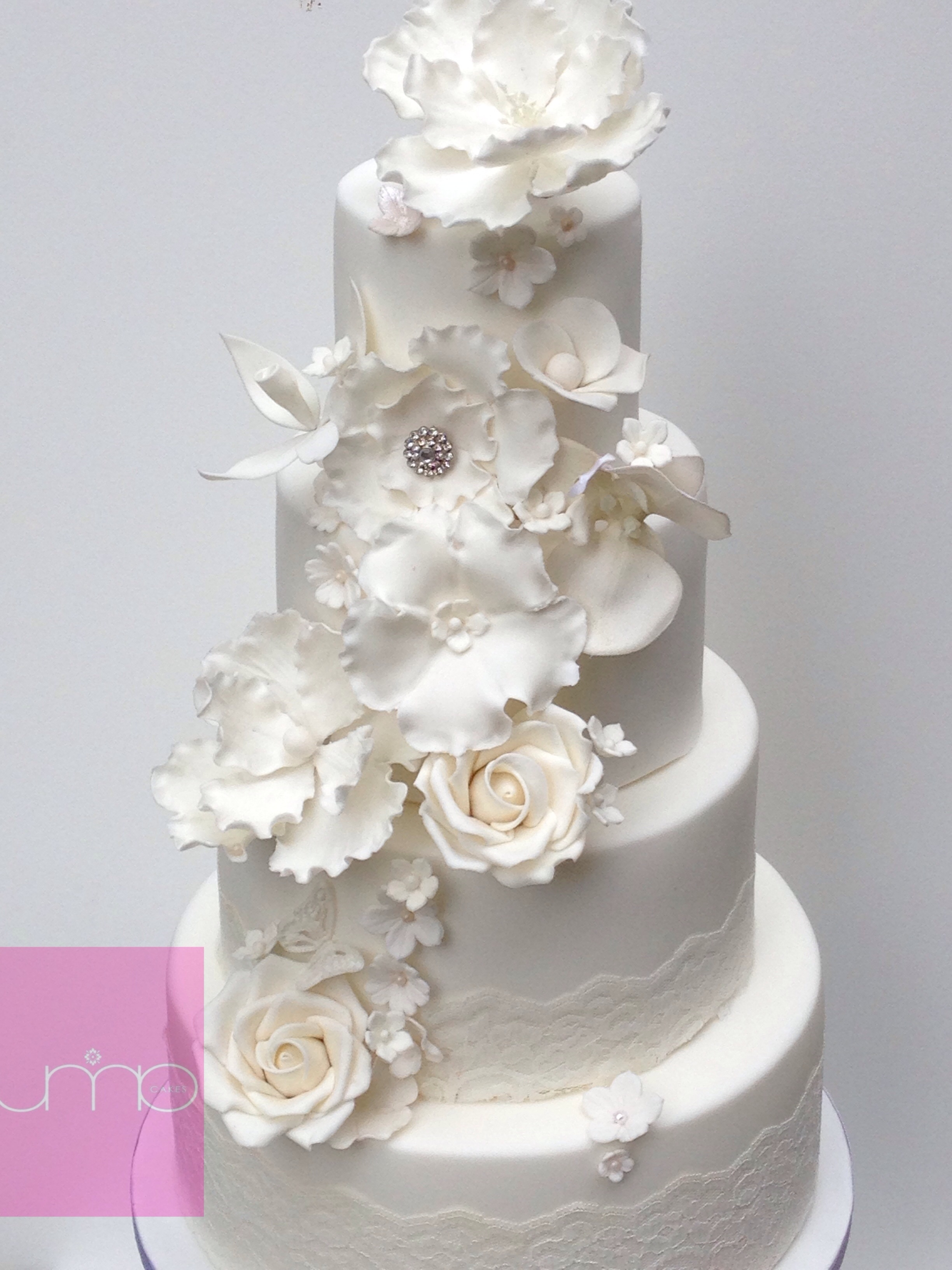 White Elegant Wedding Cake With Sugar Flowers Magnolia Orchid Roses ...