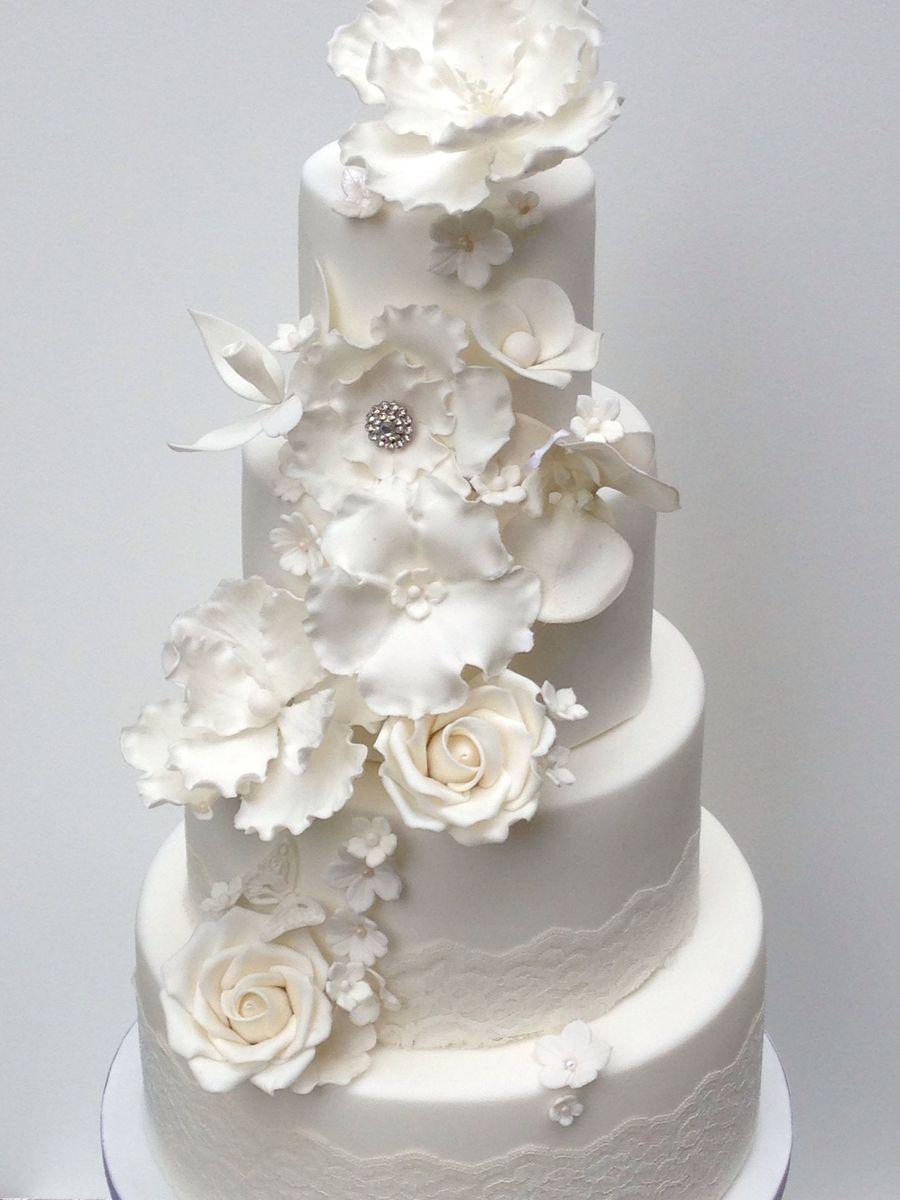 White elegant wedding cake with sugar flowers magnolia orchid roses white elegant wedding cake with sugar flowers magnolia orchid roses blossoms hydrangeas cakecentral mightylinksfo