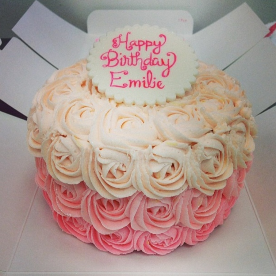 An Ombre Rose Birthday Cake With A Fondant Topper
