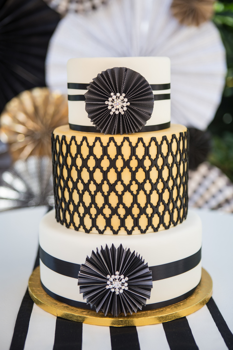 Black White And Gold Wedding Cake Incorporating The Paper Wheels And Some Bling With A Quatrefoil Center Tier on Cake Central