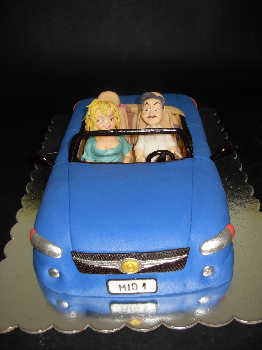 A Lovely Couple Driving Their Car on Cake Central
