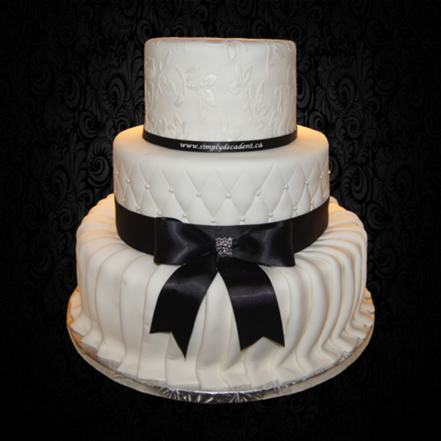 Cake With Fondant Ribbon : 3 Tier White Fondant Wedding Cake With Pleated Skirt ...