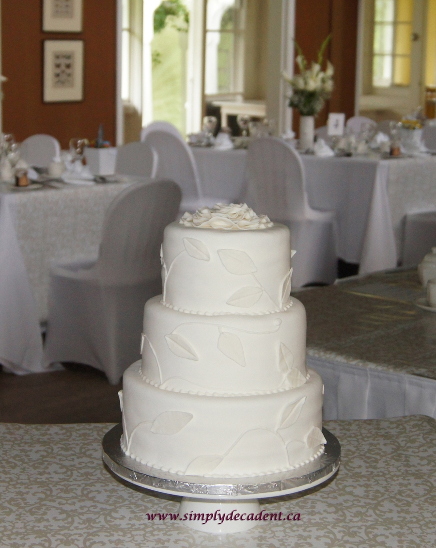 3 Tier Round Fondant Wedding Cake With Scrolling Vines Amp Leaves And Fondant Flower Topper on Cake Central