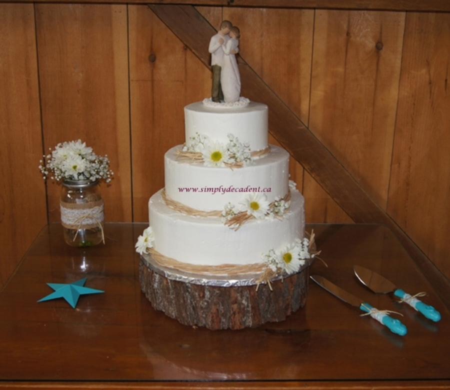3 Tier Buttercream Wedding Cake With Raffia Ribbon Amp Daisies on Cake Central