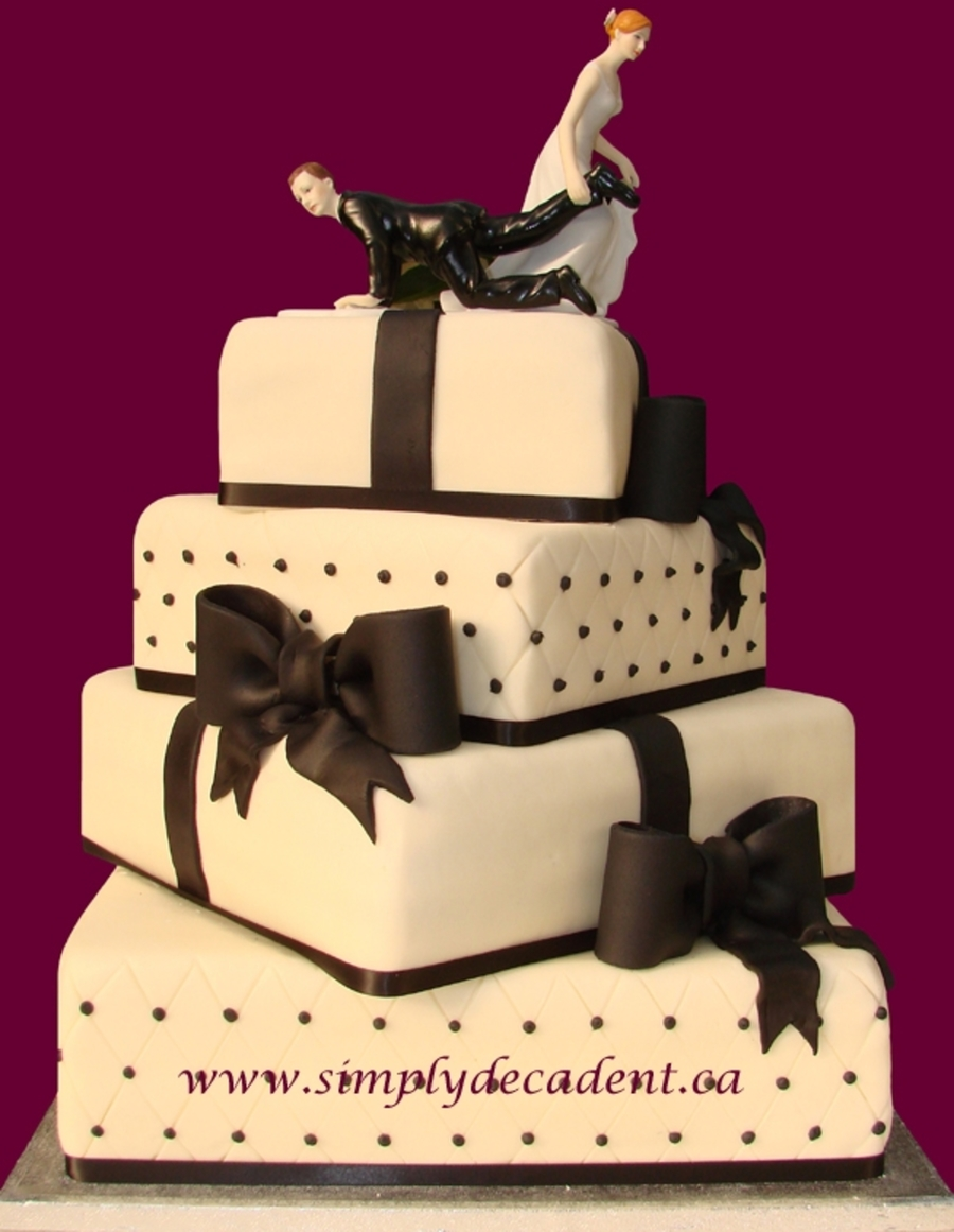 4 Tier Fondant Quilted Wedding Cake With Bows  on Cake Central