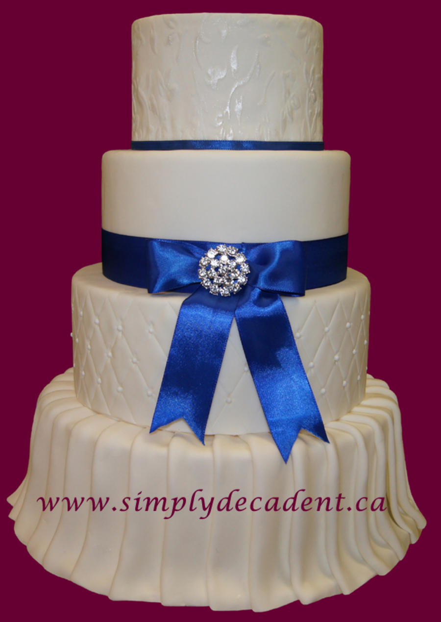 4 Tier Fondant Wedding Cake With Pleated Skirt Quilted And Textured Layers on Cake Central