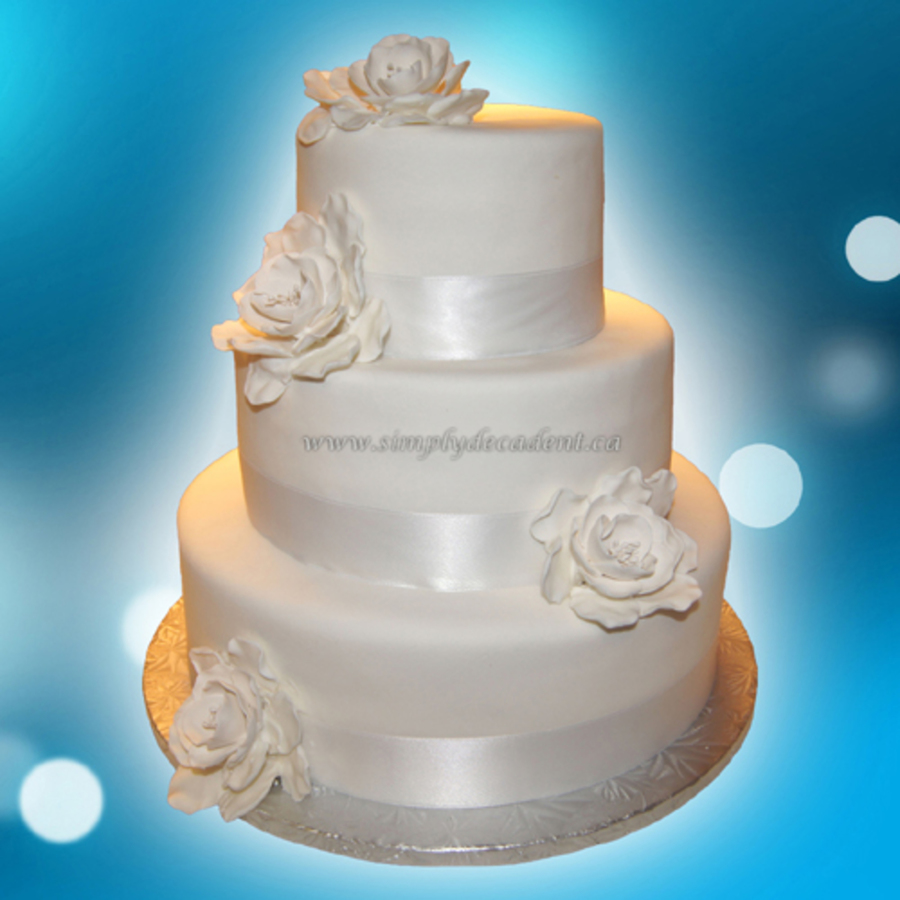 3 tier white fondant wedding cake 3 tier white fondant wedding cake with fondant roses and 10355