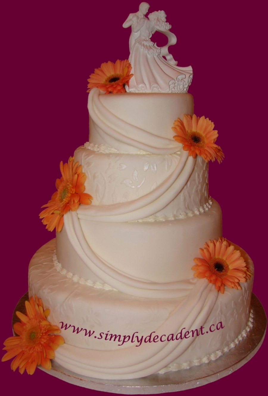 4 Tier Wedding Cake With Swags And Gerber Daisies on Cake Central