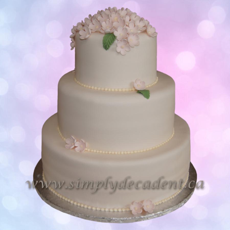 3 Tier Fondant Wedding Cake With Pink Apple Blossom Flowers