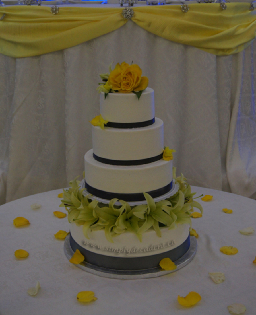 4 Tier Round Buttercream Wedding Cake With Pillars Grey Ribbon Amp Fresh Lillies on Cake Central