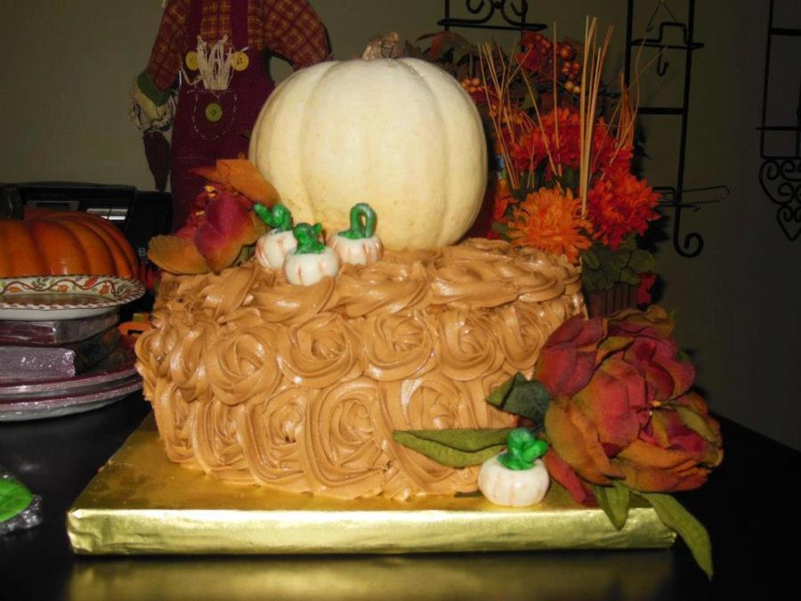 Carrot Cake Iced In Colored Cream Cheese Frosting The Big Pumpkin Is Real The Small Ones Are Modeling Chocolate And The Flowers Are Arti on Cake Central