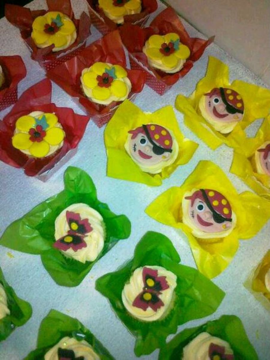 Pirate, Flower And Butterfly Cupcakes> on Cake Central