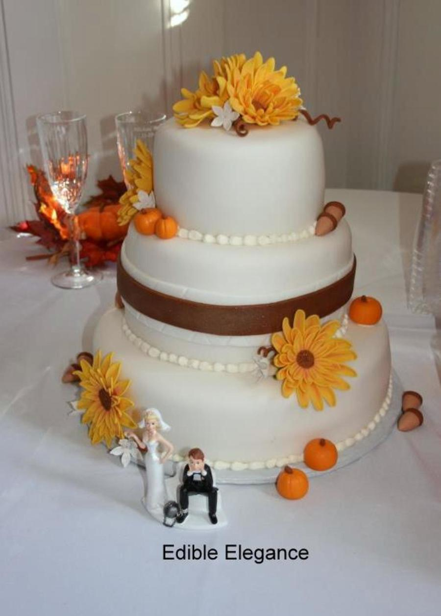 Three Tiers Covered In Fondant Decorated With Sunflowers Pumpkins And Acorns All Decorations Were Made From Fondant on Cake Central