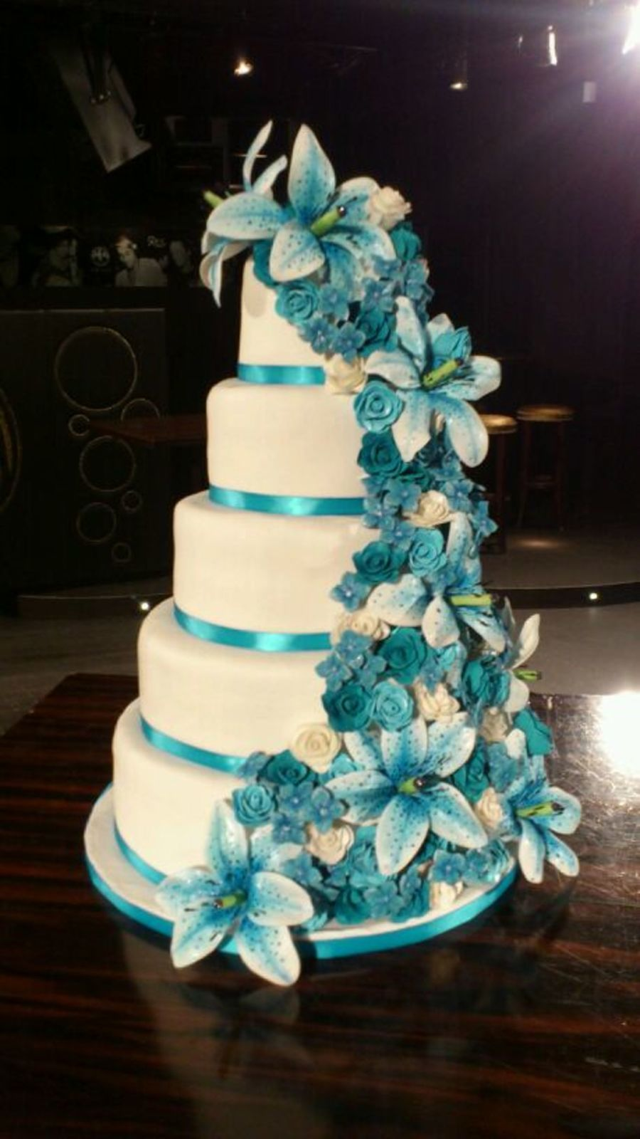 White Wedding Cake With Lots Of Blue Flowers on Cake Central