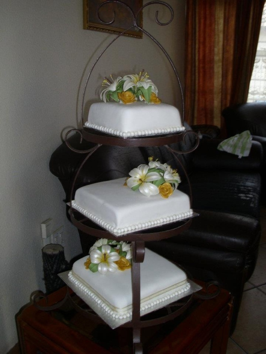 Wedding Cake - Lilies on Cake Central