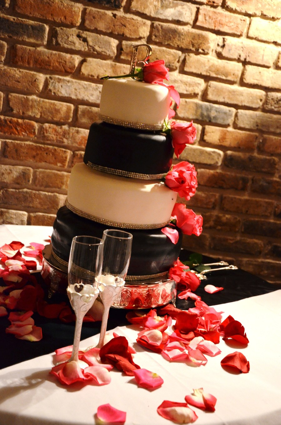 Black And White Wedding Cake With A Small Bit Of Cake Bling Around The Bottom And Pink Roses To Match The Wedding Colors on Cake Central
