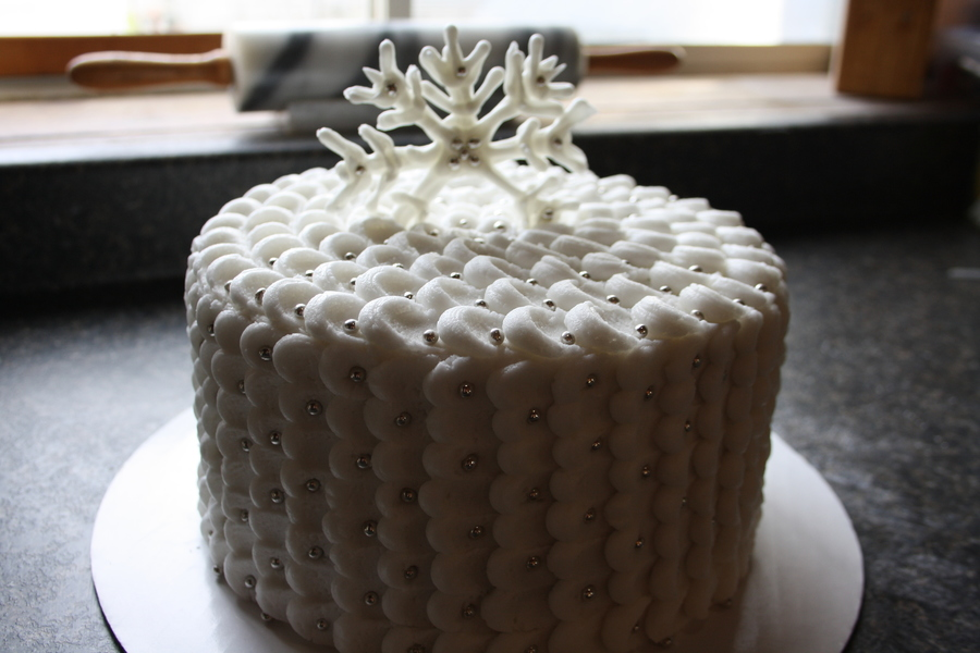 French Vanilla Petal Cake With Almond Butter Cream Icing Adorned With Silver Sugar Balls And A Snowflake Made Of Butter Cream on Cake Central