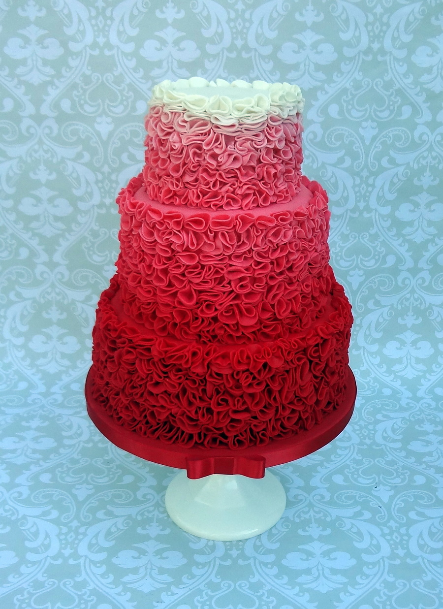 red ombre ruffle wedding cake